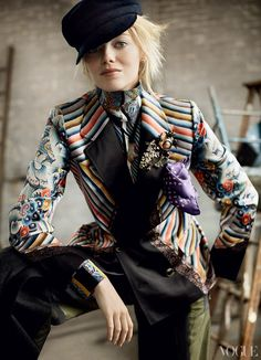 """Intimate Jest - """"This is what fashion does for people,"""" Stone says. """"It makes them feel like it's an extension of themselves."""" Dries Van Noten printed blazer, blouse, and pants. Stephen Jones cap. Charvet pocket square. Behnaz Sarafpour necklace with Venetian glass pendant. Marni brooch."""
