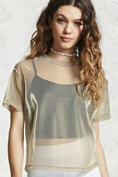 A 2-in-1 cami and tee combination featuring a knit cropped cami with a square neckline layered under a sheer round neck iridescent mesh tee .