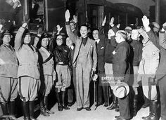 Arrival of Sir Oswald Mosley, leader of the British fascist party, at the railway station in Rome, Italy, on april 16, 1933: he was welcomed by Achille Starace, prominent leader of Fascist Italian party.