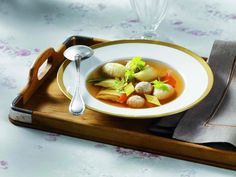 GERMANY / MEAT BROTH AND LIVER DUMPLINGS / Hockzeitsuppe  /http://www.whichmeal.com/germany/dishes/MEAT-BROTH-AND-LIVER-DUMPLINGS-574/