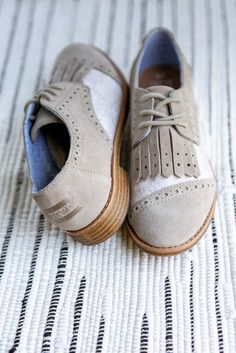 Add a vintage appeal to your look with timeless oxford style lace-up  brogues. These TOMS feature taupe suede and a kiltie. 15106301fbf