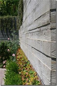 great concrete retaining wall created by staggering various widths and lengths of boards inside the form.