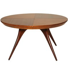 Striking and Rare Vladimir Kagan Dining Table with Two Leaves | From a unique collection of antique and modern dining room tables at http://www.1stdibs.com/furniture/tables/dining-room-tables/