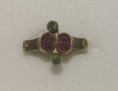 Ring 14th century Gold ring, the raised bezel of two transverse oval collets set with garnets flanked by two pearls.This ring is part of a collection of Veneto-Byzantine jewellery found in 1840 in the Castle of Chalcis on the Greek Island of Euboea (Known as Negropont by the Venetians)Euboea was one of the most important venetian colonies in the Aegean before it was captured by the Turks in 1470.