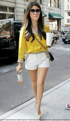 Kourtney K. rocking a yellow blouse and white shorts! #summer