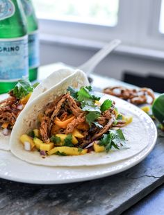 Crockpot BBQ beer pulled pork tacos with crispy onion straws and mango salsa  {How Sweet Eats}
