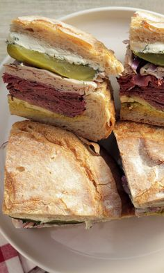 This epic sandwich is a Montreal-style riff on the classic Italian version, traditionally called a Muffuletta. Canadian Dishes, Canadian Cuisine, Canadian Food, Canadian Culture, Canadian Rockies, Soup And Sandwich, Sandwich Recipes, Montreal Smoked Meat Sandwich, Muffuletta Sandwich
