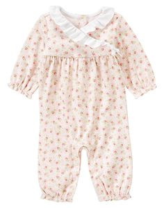 Specially designed for utmost comfort, our soft cotton interlock rosebud floral one-piece features mock wrap styling with batiste ruffle collar and bow for a sweet look. Elasticized ruffle cuffs provide a delicate finishing touch. Snaps in back and underneath assist with dressing. Fits sizes preemie to 12-18 months.