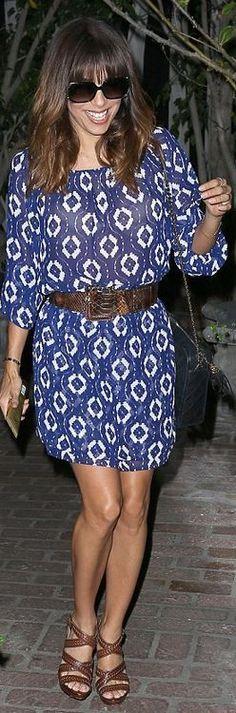 Who made  Eva Longoria's blue print dress, black handbag, and brown sandals? Dress – Show Me Your Mumu; Purse – Chanel; Shoes – Brian Atwood; Bracelet – Cartier