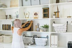 "Sneak Peek: A San Diego Home Full of Handmade Touches. ""My office is a mix of modern, vintage and industrial style.  It was originally a guest bedroom, but we ripped out the closet and built in our own shelving and cabinets to make it more useful. I found the metal storage baskets from Wisteria, the wooden desk cubby and braided cotton baskets from World Market, and the vintage wood block letters from Monki Vintage."""