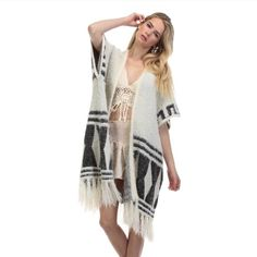 White Tribal Print Sweater Great sweater for any occasion! Soft, fuzzy, and chic! Dress it up or dress it down. This is a must have for anyone this year! Tea n Cup Sweaters Cardigans