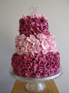 ruffle cake - The swirls are very easy to make. I just cut circles out and then pinched the sugarpaste in at the bottom and left them to dry. Once dry I trimmed the sugarpaste at the back of the swirl so I could stick it on to the cake with edible glue