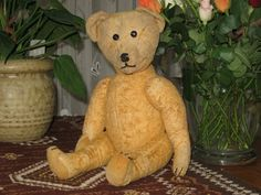 "Antique Old German Teddy Bear 40 cm Growler 1920's    If you don't know, bears with ""growlers"" are awesome."