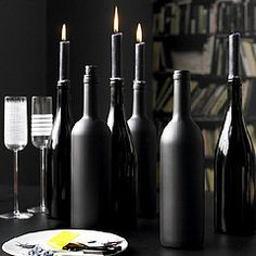 black bottles with black candles.....add melted wax down the sides