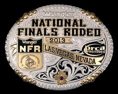 "2013 NFR Buckle - FINAL CLOSE-OUT! Most popular NFR item! Bold lettering spells out ""Wrangler National Finals Rodeo"" with the WNFR emblem shield over gold ribbons engraved with 2013 and Las Vegas, Nevada."