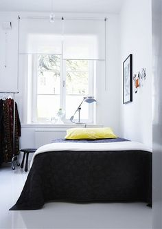 Black And White Bedroom With Yellow Pillow Shot By Swedish Photographer Per Gunnarsson