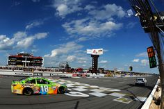 Kyle Busch, driver of the #18 M&M's Crispy Toyota, leads the field with one lap to go prior to running out of Sunoco race fuel during the NASCAR Sprint Cup Series Windows 10 400 at Pocono Raceway on August 2, 2015 in Long Pond, Pennsylvania.
