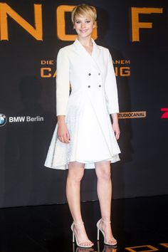 The Hunger Games: Catching Fire premiere, Berlin – November 12 2013  Jennifer Lawrence wore a dress coat from the Christian Dior pre-spring/summer 2014 collection, accessorised with Stuart Weitzman heels.