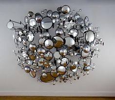 contemporary artist graham caldwell:  i find this piece of contemporary art fascinating and so appealing to the human eye. i love how the mirrors are all different sizes and seem to encircle into a globe-like shape. also, i really enjoy the glamour aspect of this contemporary artwork.