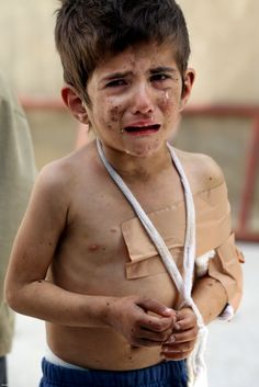 Syrian Child....enough said! I just want to hug him and hold him and make sure that he is okay. My heart is breaking....