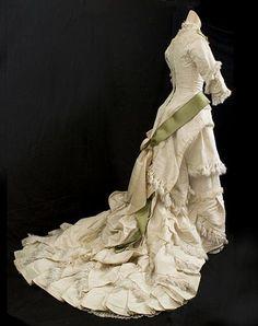 Circa 1880 Princess Line Dress: taffeta, silk faille, trimmed with delicate lace, pleated silk fringe, and satin ribbon.