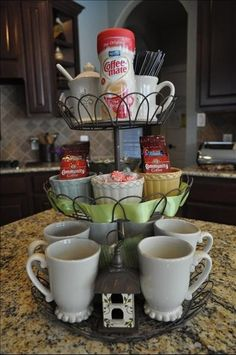 Cupcake stand as a coffee station- darling and a space saver for my teeny kitchen.
