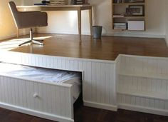 This home office has a secret bed underneath the raised floor—genius idea for a guest room