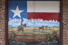 Mural depicting the wide-open spaces of the Texas panhandle, with the Texas state flag as a backdrop, on a building in McLean, Texas along old U.S. Route 66. Photo, June 2, 2014, photographer Carol M. Highsmith's America, Library of Congress Prints and Photographs Division.