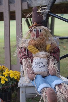this primtive scarecrow is great for fall and halloween decor!! Handmae doll and corn!! $48.99