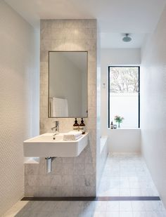 In love with the grey tile in this sleek modern bathroom. Modern Bathroom Design Ideas, Pictures, Remodel and Decor White Bathroom Inspiration, Long Narrow Bathroom, Bright Bathroom, House Bathroom, Minimalist Interior, Bathroom Layout, Modern Bathroom, Luxury Bathroom, Bathroom Inspiration