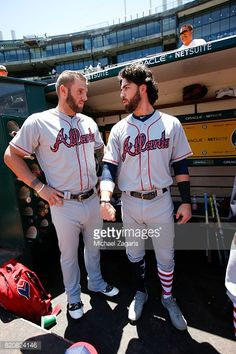 Matt Adams and Dansby Swanson of the Atlanta Braves talk in the dugout prior to the game against the Oakland Athletics at the Oakland Alameda Coliseum on July 2, 2017 in Oakland, California. The...