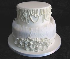 White wedding cake inspired by Spanish dress