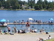 Angle Lake Park has a beachfront and a dock to jump off into the water.