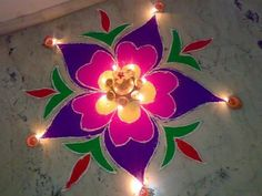 RANGOLI, aka kolam or muggu is a folk art from India. Typically consisting of bright colors, rangoli is a decorative design made during Hindu festivals . They are meant to be sacred welcoming areas for the Hindu deities. The ancient symbols have been passed down from each generation to the next, keeping both the art form and the tradition alive. They are typically created with materials including colored rice, dry flour, (colored) sand or even flower petals.