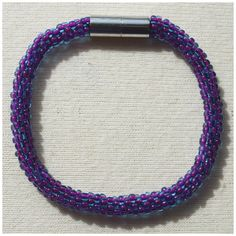 Transparent Blue with Bright Purple Centre Bead crochet rope bracelet via CherryLime Accessories. Click on the image to see more!
