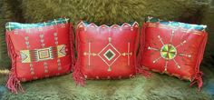 A new trio of Native American style leather pillows, hand sewn with sinew, and hand painted in mineral pigment.  Available at Stargazermercantile.com!