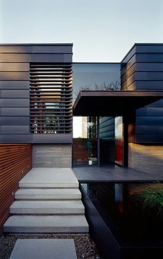 Black grey and wood. Love the concrete base.