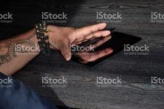 Polynesian arm with Ta Moko (Polynesian Tribal Tattoo) holding a Digital Tablet royalty-free stock photo Polynesian Tribal Tattoos, Kiwiana, Digital Tablet, Image Now, Hold On, Royalty Free Stock Photos, Arms, Business, Photography