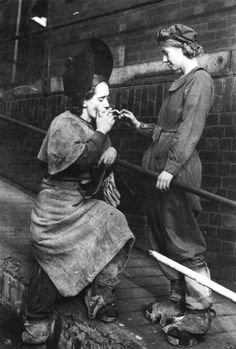 Two steel workers enjoy a cigarette while on break, November 1942
