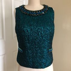 Shop Women's Anna Sui Blue Green size S Blouses at a discounted price at Poshmark. Description: Deep teal metallic, close up picture is of a pull in the fabric. Hand crafted embroidery detailing. Zip closure.. Sold by megan_l_a. Fast delivery, full service customer support.
