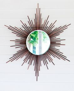How 2 make a Starburst Mirror (I would paint my wood dowels first in silver for a fancier look)