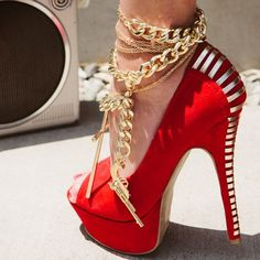 "Red & Gold ""Get'em Girl"" Pumps ! I'd feel like a badass with these !"