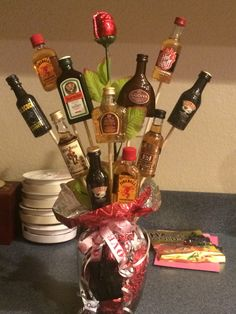 Mini Bottle Of Liquor On Dowels To Make A Gift Basket