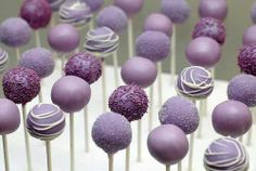 Beautiful purple cake pops!!! Someone can make me these!!