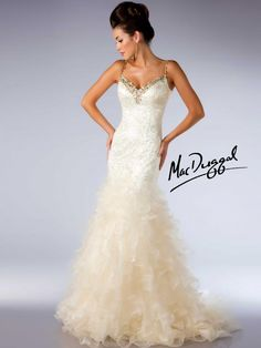 Ivory Ball Gown with Gold Accents - Mac Duggal  Ivory/gold stunning mermaid dress has low cut back, large beadwork along bustline and along straps.  Prom dress has patterned sequins and rows and rows of ruffles falling to the floor.