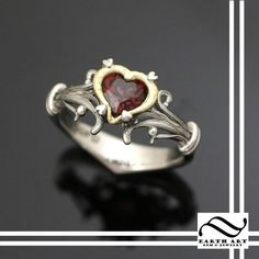 It is a Heart Container from Legend of Zelda! I kind of like the Geeky rings and the Zelda ones are pretty classy! I love them but I am not 100% sold as a my engagement ring. I can go either way.