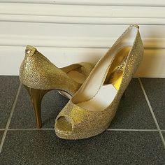 MICHAEL Michael Kors Platform NWOT Stun in these gorgeous MK gold, open toe, platform heels. These are brand new. Never worn. MICHAEL Michael Kors Shoes Platforms