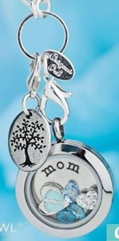 Origami Owl - Locket ideas, maybe for those having 2013/2014 babies adding the date charm as well. Visit my site:  http://charmedarmywife.origamiowl.com/ ID#52599 Like me on Facebook for all my special offers https://www.facebook.com/OrigamiOwlWendelynNelsonIndependentDesigner