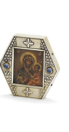 A silver-gilt and jewelled miniature icon Fabergé with Imperial Warrant, Moscow, 1908-1917 in the Old Russian taste, the hexagonal frame enriched with scrolls and pellets, crosses and cabochon stones encasing the Mother of God Hodegitria  88 standard.