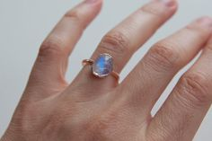 Loving this moon stone! Rainbow Moonstone Ring in 14k Rose Gold free by erinjanedesigns